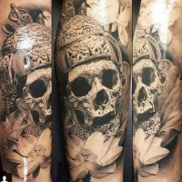 Very detailed colored realism style tattoo of ancient skull in helmet with lotus flower