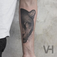 Very detailed forearm tattoo of split black panther head by Valentin Hirsch
