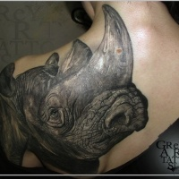 Very detailed large realism style scapular and shoulder tattoo of rhino head