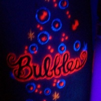 Very interesting black light bubbles tattoo
