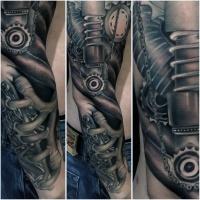 Very realistic looking impressive biomechanical tattoo on sleeve