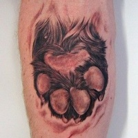 Very realistic looking little colored animal paw tattoo on arm
