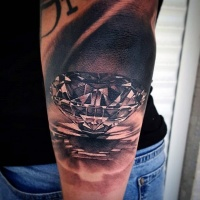 Very realistic looking pure diamond tattoo on arm