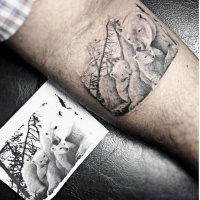 Very realistic looking white bear family tattoo on arm