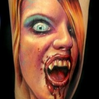 Very realistic painted colored bloody female vampire tattoo on arm