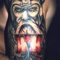 Viking ship with red sails tattoo