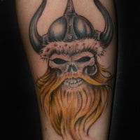 Viking skull with a red beard in a horned helmet