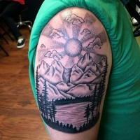 Vintage black ink lake tattoo on shoulder with mountains and sun