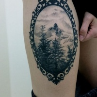 Vintage like black and white nature picture tattoo on thigh