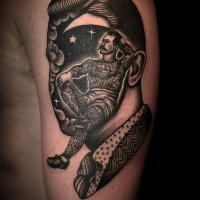 Vintage like painted black and white portrait with man instead of face shoulder tattoo