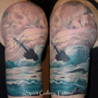 Vintage picture like shoulder tattoo of sailing ship in stormy sea