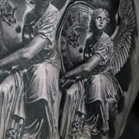 Vintage style black and white angel statue tattoo on shoulder with antic clock