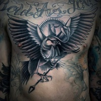 Vintage style black and white eagle with arrow tattoo on chest