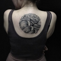Vintage style black and white ocean waves with wale tail tattoo on upper back