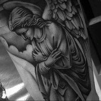 Vintage style black ink detailed tattoo of angel