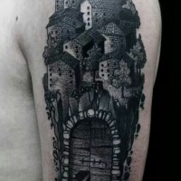 Vintage style black ink shoulder tattoo of old medieval town with gates