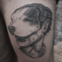 Vintage style black ink thigh tattoo of woman with dog mask