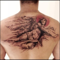Vintage style colored back tattoo of angel