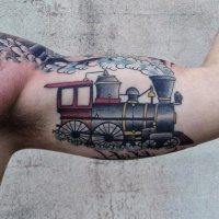 Vintage style colored biceps tattoo of fast train