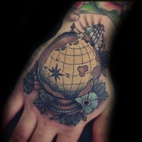 Vintage style colored hand tattoo of little globe with flowers