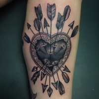 Vintage style colored human heart with arrows tattoo