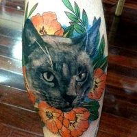 Vintage style colored leg tattoo of cat with nice flowers