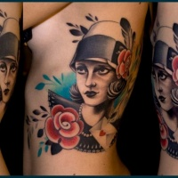 Vintage style colored side tattoo of woman portrait with red flowers and little bird