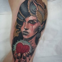 Vintage style colored tribal woman portrait tattoo on arm with human heart