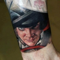 Vintage style multicolored angry man tattoo on ankle