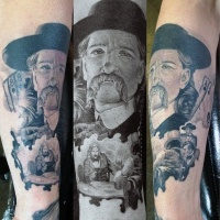 Vintage style painted black and white western cowboy portrait tattoo on arm