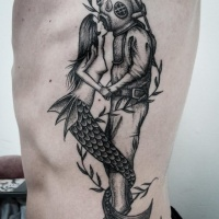 Vintage style painted black and white diver with mermaid tattoo on side