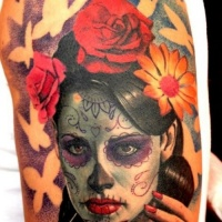 Vivid colors adorable santa muerte with flowers in black haired tattoo on shoulder