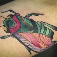 scarabeo vivaci colori tatuaggio sul braccio