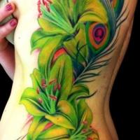Vivid colors flowers tattoo on ribs