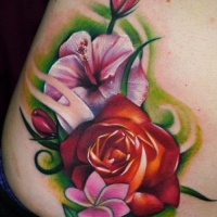 Vivid colors hibiscus and roses  tattoo