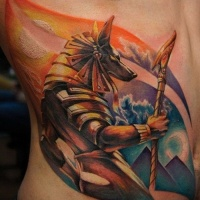 Watercolor anubis tattoo on ribs