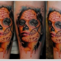 Watercolor day of the dead girl face tattoo on arm