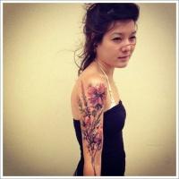 acquarelli fiori tatuaggio mezza manica per ragazza
