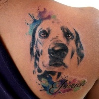 Watercolor like memorial style shoulder tattoo of dog portrait with lettering