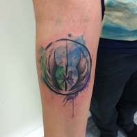 Watercolor style amazing looking Star Wars emblem tattoo on forearm