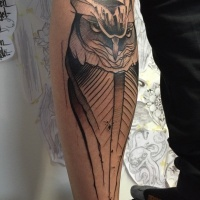 Watercolor style arm tattoo of big steady owl