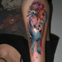 Watercolor style colored arm tattoo of funny bird