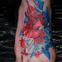 Watercolor style colored foot tattoo of unicorn
