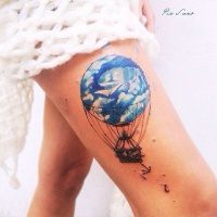 Watercolor style colored thigh tattoo fo flying balloon with anchor