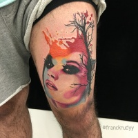 Watercolor style colored thigh tattoo of woman with big tree
