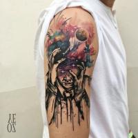 Watercolor style colored upper arm tattoo of sad man with night sky and moon