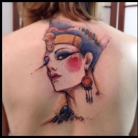 Watercolor style cool looking upper back tattoo of ancient Egypt queen