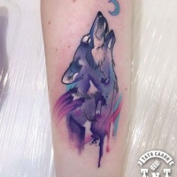 Watercolor style cute looking arm tattoo of wolf with moon