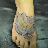 Watercolor white lotus tattoo on foot