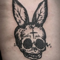 Weird dark black ink skull with bunny ears tattoo in homemade style